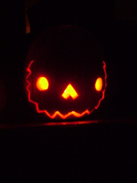 My pumpkin, glowing with the demonic inner light of self-confidence . . . and a candle.
